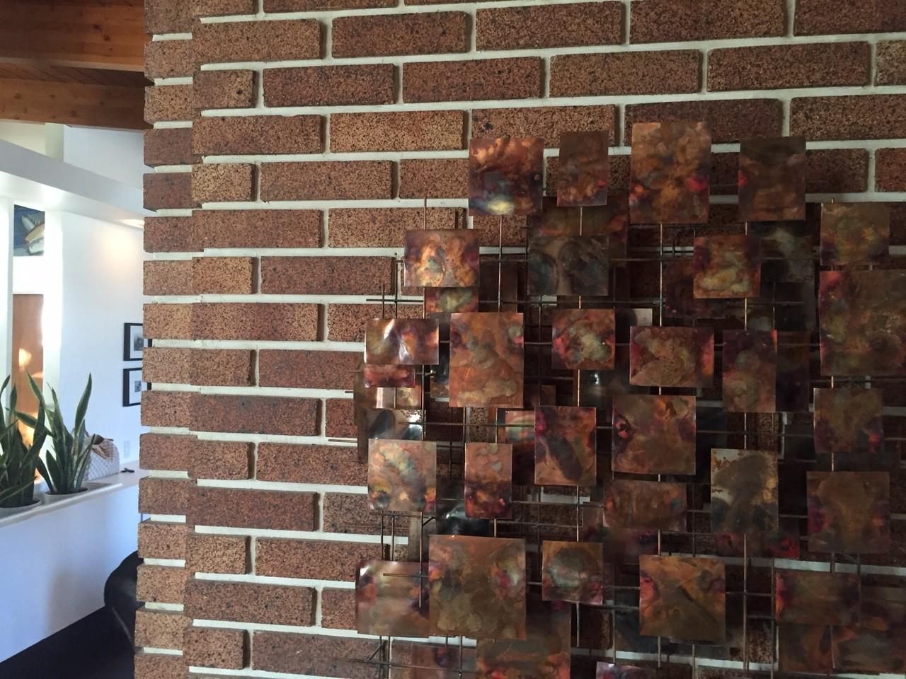 Claybank brick wall in Calgary Trend House